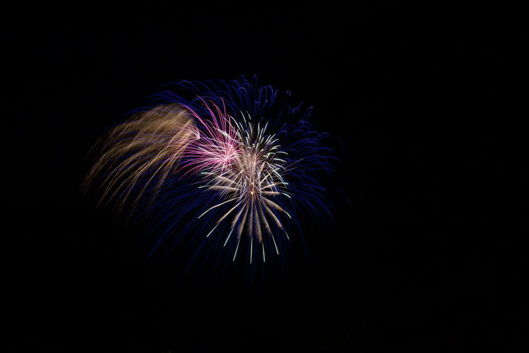 Arts Culture And Entertainment Astronomy Black Background Celebration Exploding Firework - Man Made Object Firework Display Illuminated Long Exposure Multi Colored Night No People Outdoors Sky