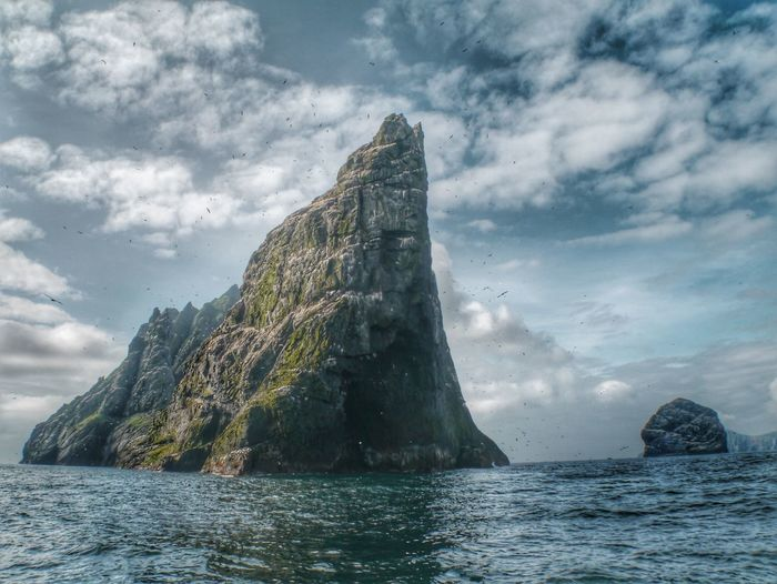 St.Kilda, Dual Unesco World Heritage site St.Kilda,swim, Adventure,life Changing , Sport, Unique, Happy, World Heritage Site St.kilda VisitScotland Unesco UNESCO World Heritage Site Cloud - Sky Sky Water Nature Sea Day Rock Waterfront No People Beauty In Nature Scenics - Nature Rock - Object Outdoors Tranquil Scene Tranquility Solid Low Angle View Rock Formation Sunlight Stack Rock