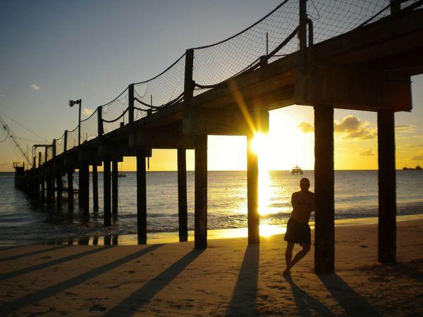 Sunset Sea Water Sun Sunlight Beach Sky Silhouette Horizon Over Water Outdoors Summer Nature