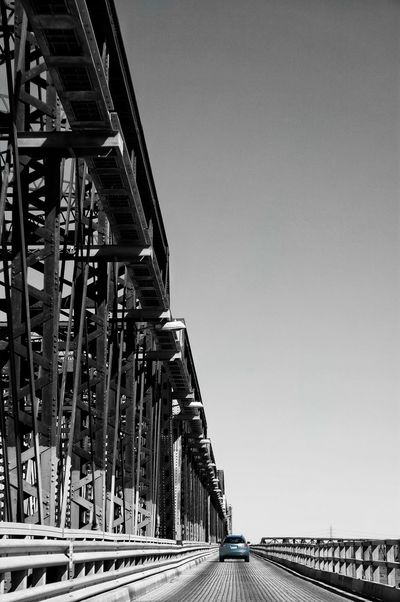 """The journey of a thousand miles begins with a single step."" — Lao Tzu. Break The Mold Urban Blackandwhite Travel Getting Inspired Enjoying Life Urban Exploration Black & White Urban Landscape Getting Creative Bridge - Man Made Structure Bridges Bridge Bridgeporn Bridgesaroundtheworld Bridges_aroundtheworld Montréal Canada Car Cars Journey Adventure Gray Gray Background Simple Background The Architect - 2017 EyeEm Awards Let's Go. Together. Visual Creativity"