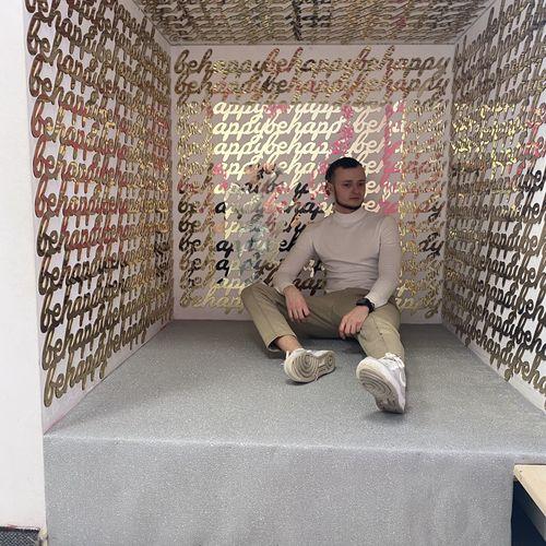 Full length portrait of boy sitting on floor