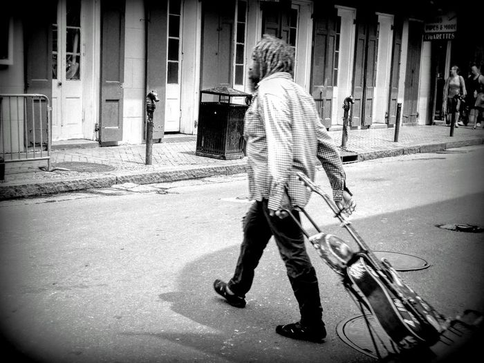 People And Places Building Exterior Architecture Street Outdoors Person Casual Clothing Architectural Column Burbon Street Musical Instrument String Musical Instrument Musical Equipment New Orleans Musical Instruments