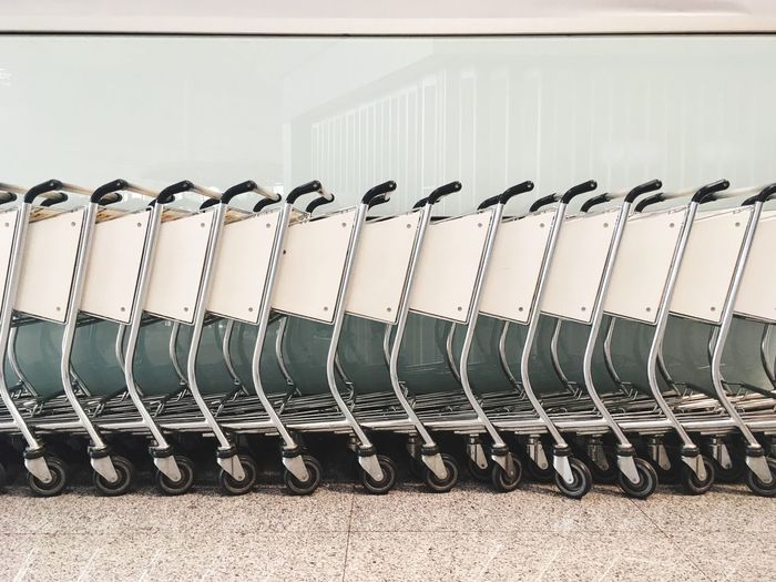 Shopping carts against glass at beijing capital international airport