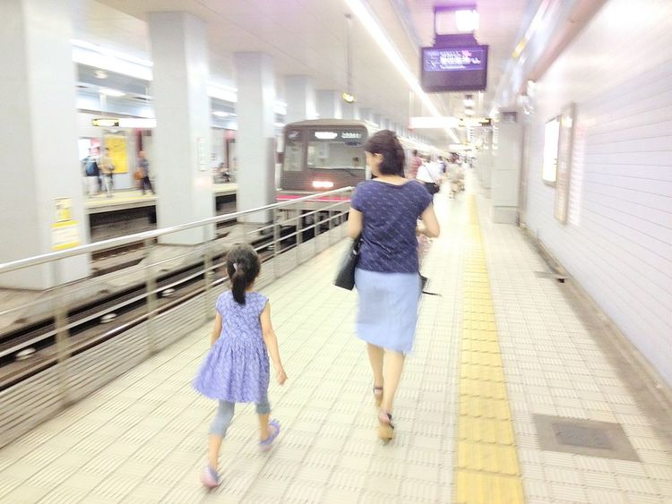 My wife and daughter Subway Station Hurry Up! Backward Portrait