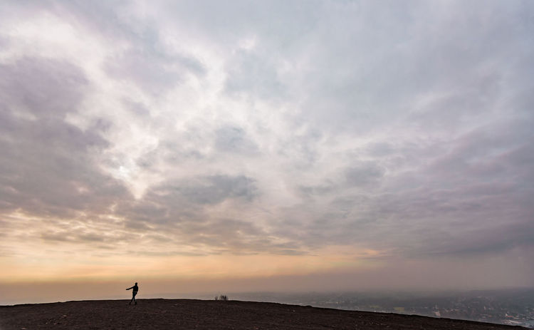Beauty In Nature Bottrop Cloud - Sky Clouds And Sky Cloudy Dancing Dancing Girl Dawn Day EyeEmNewHere German Halde Haniel Industrial Culture Nature One Person Outdoors Scenics Silhouette Sky Sunrise Young Adult The Secret Spaces