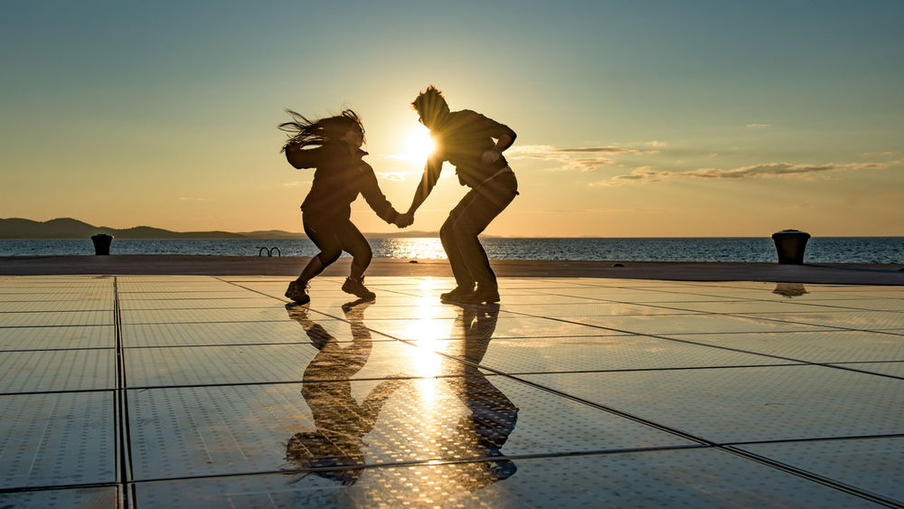 Having fun in Zadar 40 Something Beauty In Nature Couple Dance Hair Happiness Horizon Over Water Idyllic Jump Let Your Hair Down Life Lifestyles Love Outdoors Pretty Reflection Scenics Selfportrait Solar Power Sunset Two Is Better Than One Together Water Paint The Town Yellow