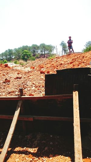 The KIOMI Collection Myanmar Train Ride To Thazi Terracotta Color Soil Climbing The Mountain Landscape Burma Birma Shan State Pile Of Sand Burmese Man Burmese Boy On The Way