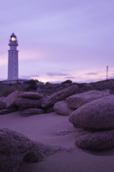 Follow the light Architecture Beauty In Nature Cloud - Sky Direction Distance Dramatic Sky Guidance Lighthouse Nature No People Non-urban Scene Out Of Focus Outdoors Protection Purple Rocks Safety Sand Scenics Security Sky Sunset Tranquil Scene Tranquility