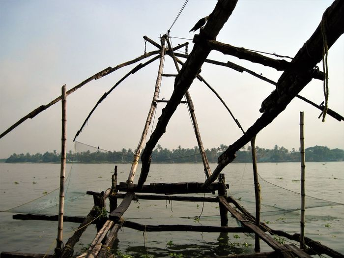 Beauty In Nature Chinese Fishing Net Day Horizon Over Water Kochi, India Nature No People Outdoors Scenics Sea Sky Tranquility Water