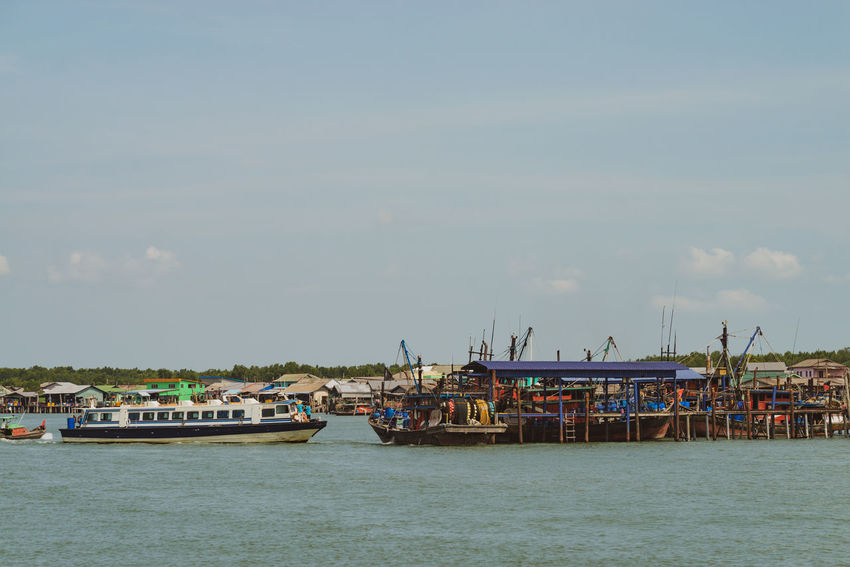 A view of a fishermen's village on stilts besides the sea in Pulau Ketam (Crab Island). This island is famous for sea food products and restaurants. Architecture Beauty In Nature Building Exterior Built Structure Cloud - Sky Crab Island Day Harbor Mode Of Transportation Moored Nature Nautical Vessel No People Outdoors Passenger Craft Pulau Ketam Malaysia Sailboat Sea Ship Sky Transportation Water Waterfront