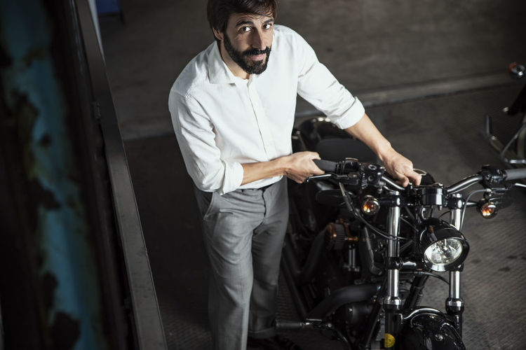 Facial Hair Garage Looking At Camera Standing Transportation Men Motorcycle Indoors  Biker Bikers Gentlemen Motorbike Engine Beard Black And White 40 Years Old Executive  Manager Directing White Shirt Neat