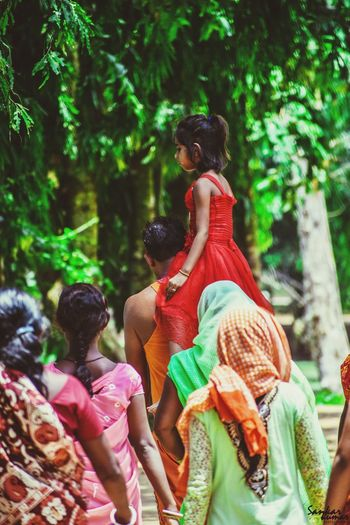 Togetherness Adult Holi Men People Celebration Multi Colored Red Tree Outdoors Sitting Friendship Lifestyles Women Day Happiness Young Women Young Adult Adults Only Bride
