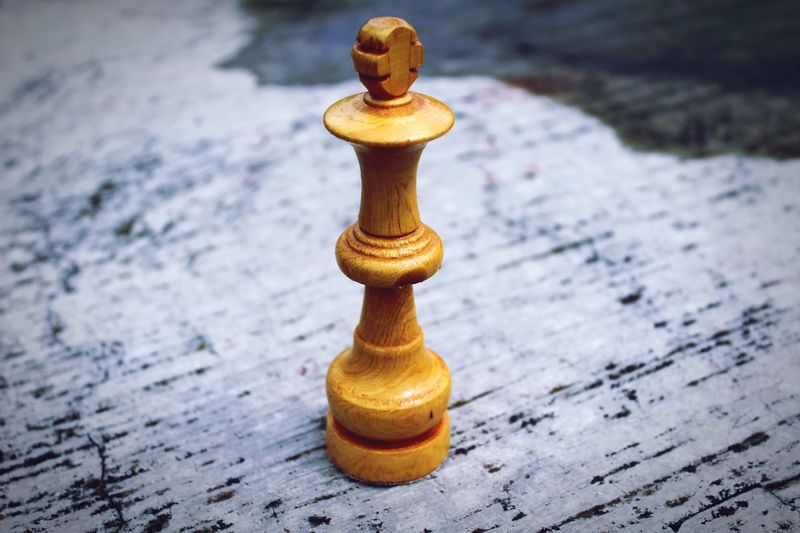 Close-up of chess piece on marble