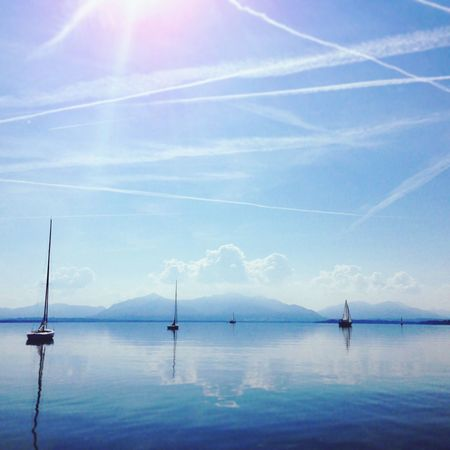 Sea Nature Beauty In Nature Water Sky Outdoors Sunlight Horizon Over Water Nautical Vessel Sailboat Cloud - Sky Mirror Effect Mirrored Reflection Sailing Nowind Lakeside Lake View Mountains Nautical Nautical Theme Boat Boats And Water