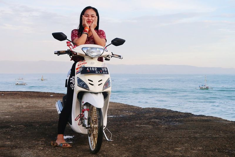 girl and motorcycle EyeEm Best Shots Fhotography EyeEmNewHere EyeEm Selects EyeEm Gallery Eye4photography  West Java  Beachphotography PelabuhanRatuBeach Portrait Sea Full Length Smiling Beach Young Women Women Happiness Sand Surfing A New Beginning EyeEmNewHere