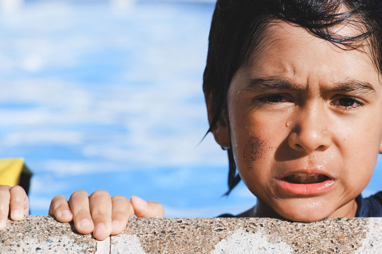 Close-Up Portrait Of Boy In Swimming Pool