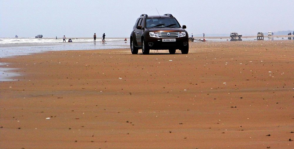Enjoyment on Beach Arid Arid Climate Arid Landscape Barren Beach Driving Car Copy Space Day Desert FootPrint Landscape Mandarmani Natural Pattern Objects Outdoors Recreational Pursuit Remote Sand Sand Dune Summer Unrecognizable Person Vacations Weekend Activities