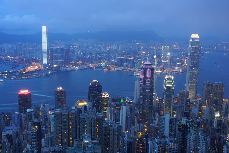 Architecture Blue Hour Cityscape Building Exterior Building Story Built Structure City Cityscape Development Dusk Financial District  Growth High Angle View Illuminated Modern Night Night Photography Office Building Sky Skyscraper Tall - High Tower Travel Destinations Victoria Harbor Water Battle Of The Cities
