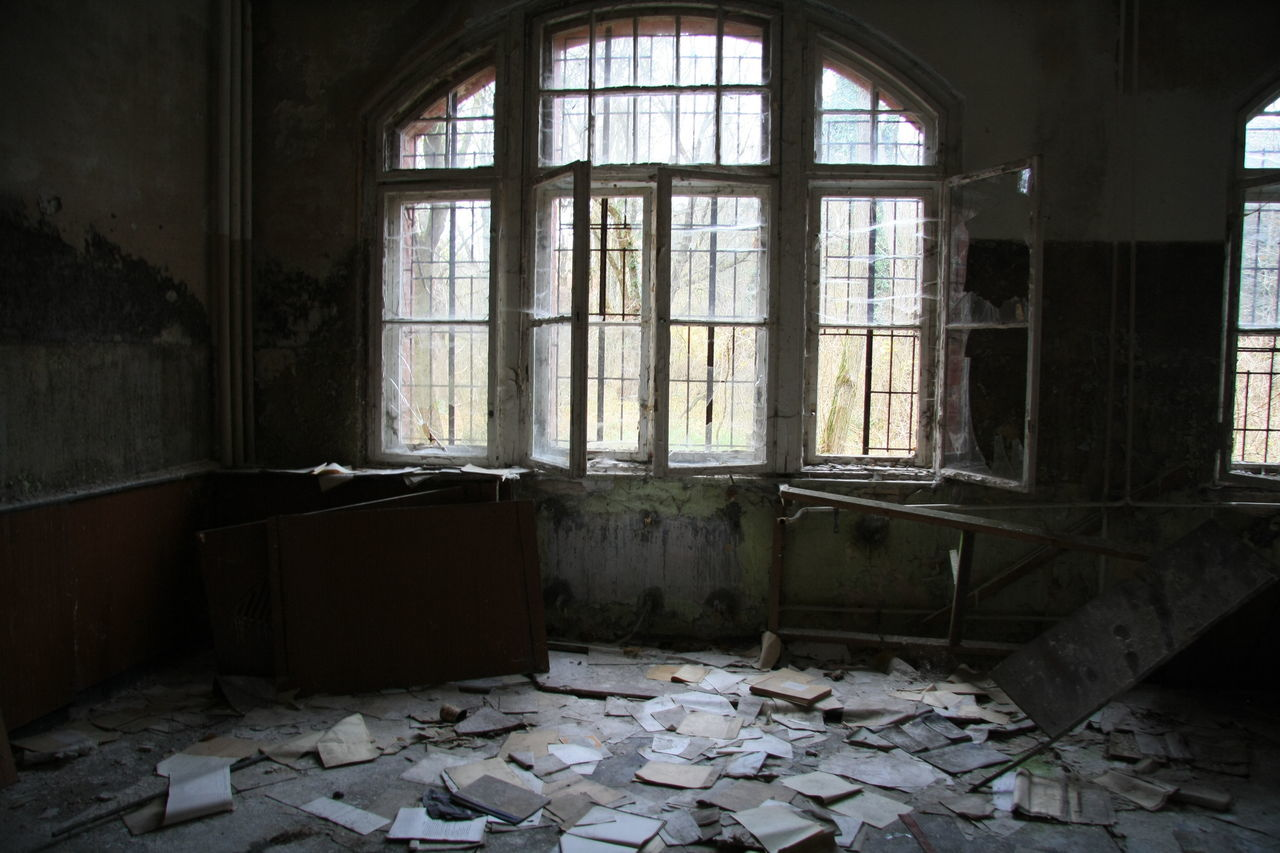 Messy Papers In Abandoned Building Room