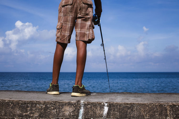 Man fishing at the Malecòn, Havana, Cuba. Cuba Fisherman Fishing Fishing Time Havana, Cuba Horizon Over Water Human Body Part Human Leg Man Relaxing Sea Sea And Sky Seascape Standing