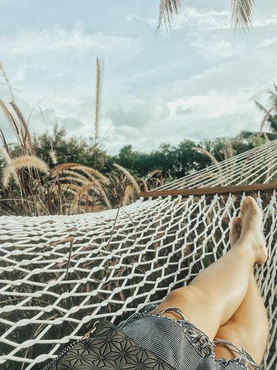 Woman is sleeping in the hammock. Woman Sleeping Hammock Swing Relaxing Vacations Holiday Slow Life Legs