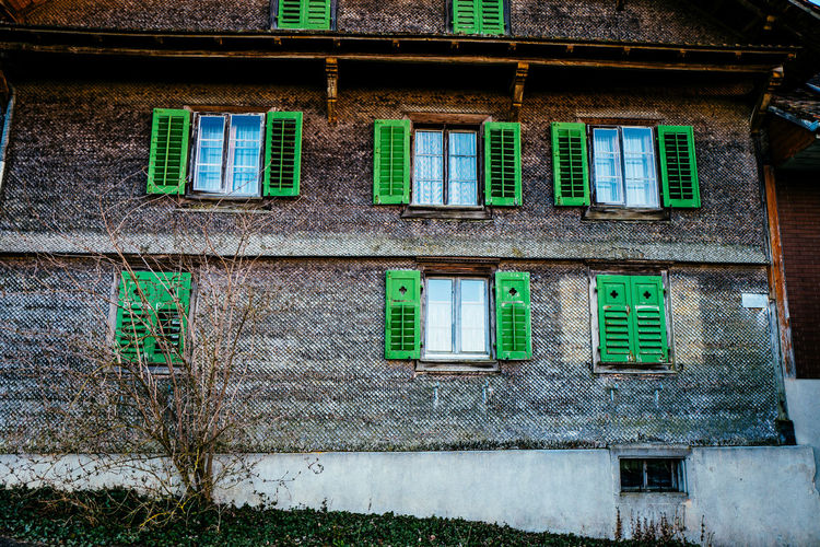 Abandoned Architecture Building Exterior Built Structure Choice Colorful Day Gormund Green Color High Angle View In A Row Kapelle Large Group Of Objects Multi Colored No People Outdoors Side By Side Stone Wall Variation Wall Wall - Building Feature Window