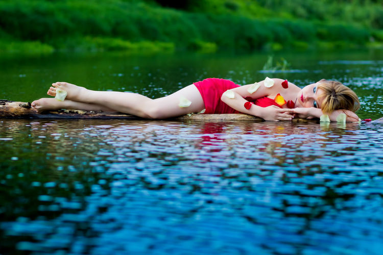 Blonde Blonde Girl Blue Eyes Blue Water Lying Down Lying In The Water Red Red Dress Red Fabric Red Lips Redhead River River Collection Riverbank Riverside Riverside Photography Rose🌹 Summer Summertime Sunset Young Adult Young Women light and reflection Sommergefühle