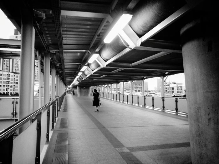 alone City City Life Shadow Shade Light Light And Shadow Woman Walking Walk Way Walkway Train Station Alone Blackandwhite Black And White Black & White Monochrome Metropolis Bangkok Thailand BTS Perspective Wide Angle Built Structure Pathway Railroad Station Subway Station