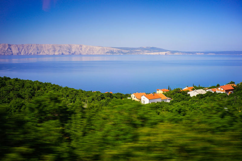 Blue ocean and mountain view Water Mountain Scenics - Nature No People Beauty In Nature Building Exterior Architecture Building Land Sky Plant Landscape Sea Nature Tranquility Tree Environment Built Structure Outdoors Village