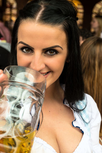 Portrait Of Young Woman Holding Beer Glass During Oktoberfest