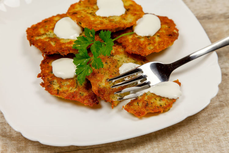 Potato pancakes with sour cream and parsley on a wooden table Homemade Meal Potato Ukrainian  Vegetarian Breakfast Close-up Directly Above Eating Utensil Food Food And Drink Fork Freshness Garnish Healthy Eating High Angle View Indoors  Indulgence Kitchen Utensil No People Plate Potato Pancake, Ready-to-eat Sackcloth Serving Size Spoon Still Life Table Table Knife Temptation Vegetarian Food Wellbeing
