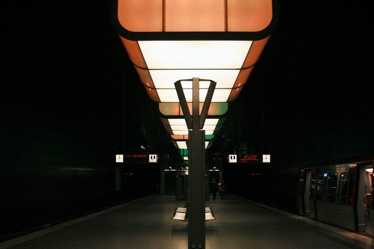 Illuminated underground walkway at night