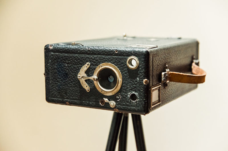 Close-up of old camera against white background