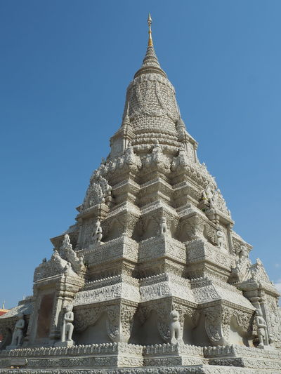 Low angle view of a temple against clear blue sky