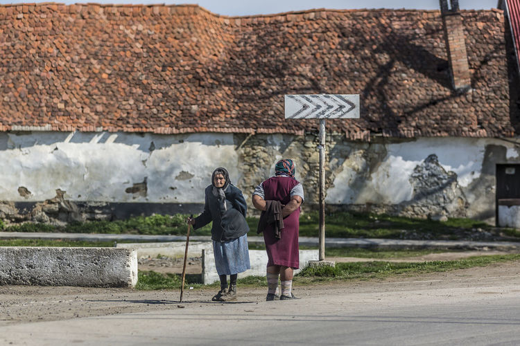 Two older women in a village in western Romania. Two People Architecture Full Length Men Togetherness Adult Building Exterior Built Structure Women Real People People Bonding Day Couple - Relationship Senior Adult Clothing Walking Leisure Activity Lifestyles Positive Emotion Warm Clothing Outdoors Old Women Cain