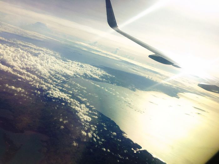 Aerial View Nature Airplane Wing Beauty In Nature Airplane Scenics No People Transportation Journey Tranquil Scene Flying Tranquility Day Aircraft Wing Mid-air Sky Outdoors Sea Landscape Air Vehicle