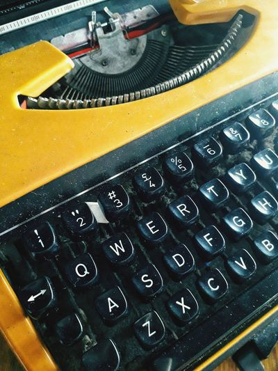 The typewriter Typewriter Technology Old-fashioned Yellow High Angle View Retro Styled Close-up Alphabet Analog Keyboard Machine Western Script Information Text Vintage Typescript Signboard Capital Letter Push Button Computer Key