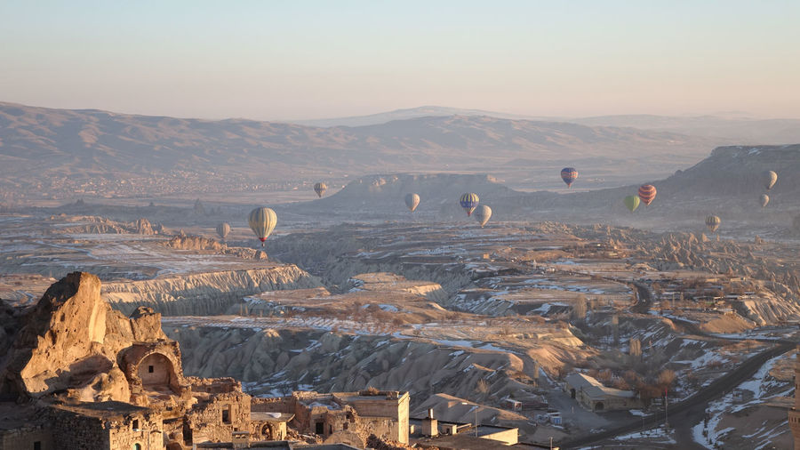View of hot air balloons on mountain