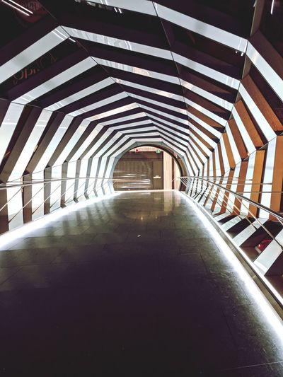 the way In ! 🚶 EyeEmNewHere Lighting Decoration Shopping Mall Maze Arcitecturephotography City Modern Architecture Built Structure Bridge - Man Made Structure Suspension Bridge Chain Bridge Tunnel Light At The End Of The Tunnel Engineering Footbridge