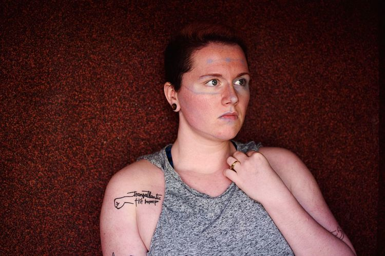 Blue structures. Not Your Cliche Short Hair Tattoo This Is Queer Queer Tattoo One Person Portrait Front View Looking At Camera Indoors  Headshot Young Adult Body Part Casual Clothing Lifestyles