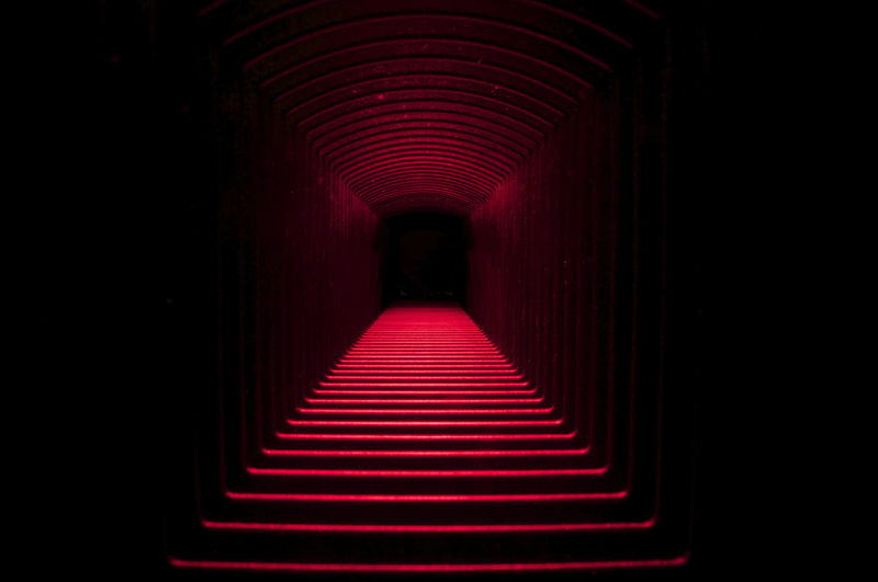 Interior Of Illuminated Red Tunnel