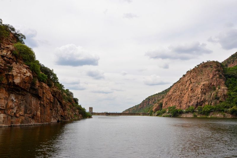 Hartebeespoort dam wall . Sky Scenics Rock Formation Nature Cloud - Sky Day Mountain Beauty In Nature No People Tranquility Rock - Object Outdoors Tranquil Scene Water Hartebeespoort Hartbeespoort Dam Hartbeespoort Dam Wall Traveling South Africa Snake Park