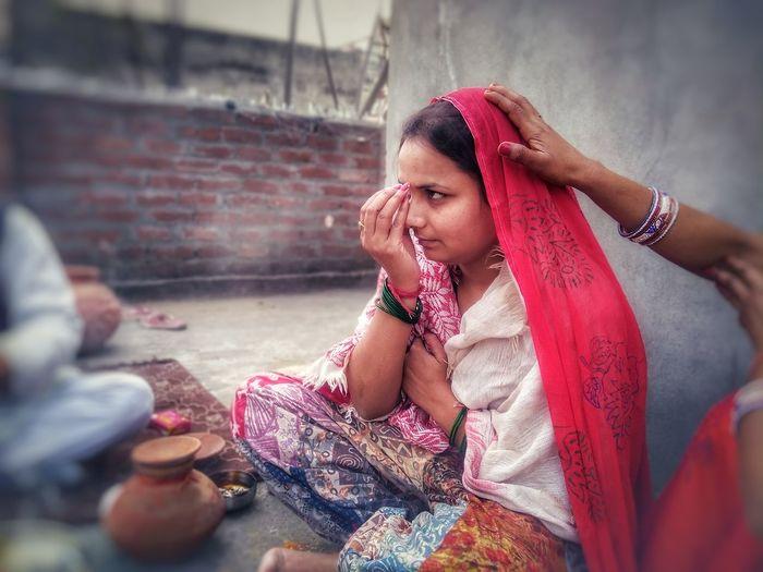 Women Sitting Outside Building