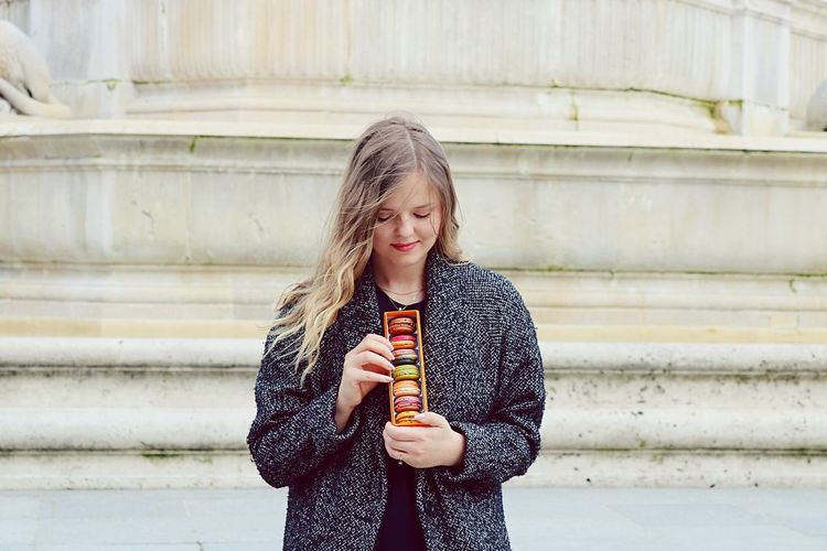 Macarons EyeEm Selects Happiness Holding Smiling Outdoors One Person Food And Drink Lifestyles Cheerful Portrait Day Standing Refreshment Beauty Young Women Only Women Real People Beautiful Woman