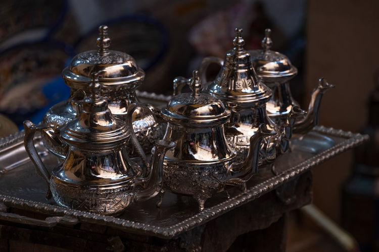 Close-up of  traditional arabic silver tea pots on tray