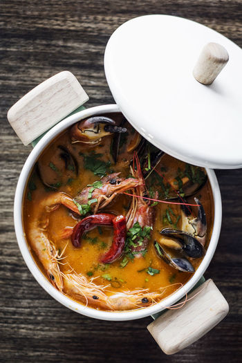 thai red curry seafood soup Thai Red Curry Bowl Close-up Day Food Food And Drink Freshness Healthy Eating High Angle View Indoors  No People Noodle Soup Ready-to-eat Red Curry Seafood Curry Seafood Soup Serving Size Soup Soup Bowl Table Thai Food
