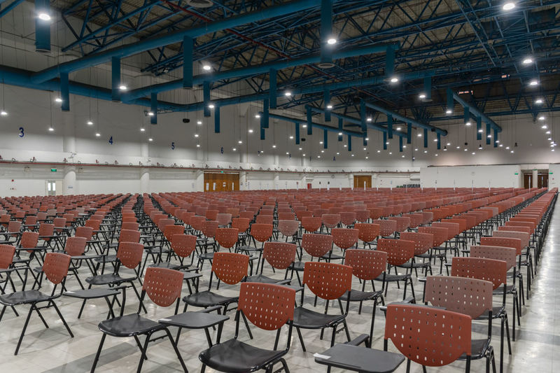 Absence Architecture Auditorium Chair Day Empty Illuminated In A Row Indoors  Large Group Of Objects Lecture Hall No People Seat Seminar Table