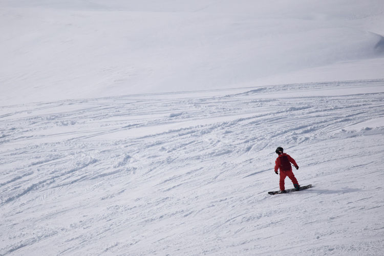 Full length of person skiing on snow covered landscape