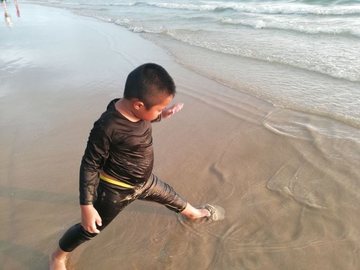 Children enjoy on summer trip 2019,หาดเจ้าหลาว Achi2019 Boy Water Beach Land One Person Sea Child Leisure Activity Childhood Men Boys Real People Lifestyles High Angle View Motion Casual Clothing Males  Sand Nature Outdoors Innocence
