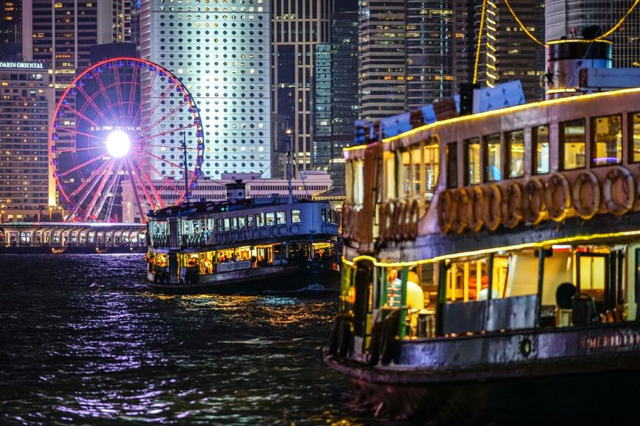 Nightshooters Nightscapes Discoverhongkong Reframinghk cityscapes Building Exterior Architecture Built Structure Water Illuminated Night City Nautical Vessel No People River Travel Destinations Building Transportation Amusement Park Waterfront Amusement Park Ride Nature Ferris Wheel Outdoors Lens Flare